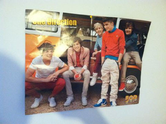 which musician has a poster of one direction on their wall tigerbeat