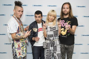 DNCE & Nicki Minaj Drop 'Kissing Strangers' Lyric Video Featuring Adorable Dogs