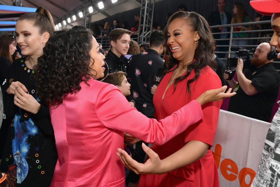 Nia Sioux Interviews Celebs on the KCA Orange Carpet