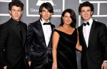 The Jonas Brothers and their mom, Denise