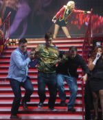 Taylor's fan is escorted off Stage